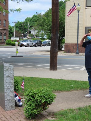 Frank Fuller Jr., a member of Tri-State Naval Ship VFW Post 7241, placed a wreath at the Disabled Veterans monument in Orange Square.