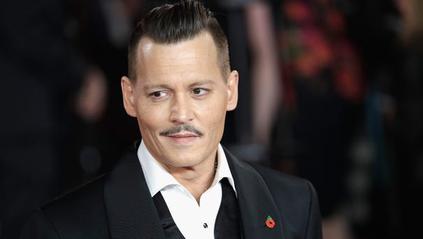 Johnny Depp sported a finely coiffed pompadour at...