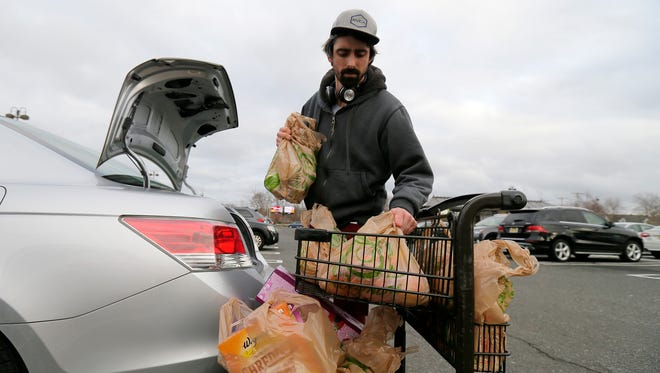 Jack McKee of Bradley Beach pushes his cart of groceries packed in recycled plastic bags at Wegmans in Ocean Twp., NJ Tuesday January 16, 2018.