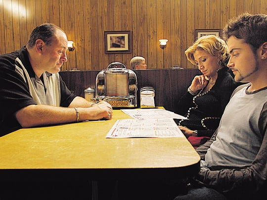 "The final scene of ""The Sopranos,"" shot at Holsten's in Bloomfield. From left are actors James Gandolfini as Tony Soprano, Edie Falco as Carmela and Robert Iler as Anthony Jr."