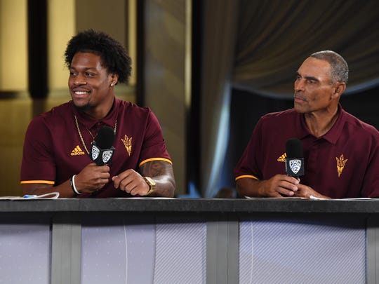 Arizona State receiver K'Neal Harry (left) and head coach Herm Edwards speak during Pac-12 Media Day on July 25, 2018.