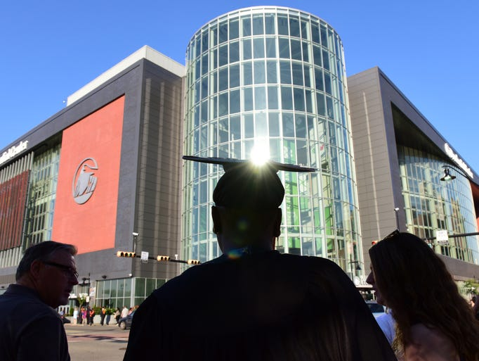 A graduate approaches the Prudential Center for her