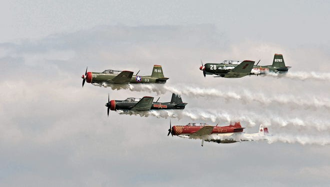 Various Warbirds  perform during AirVenture 2014.