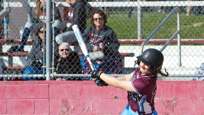 Ballard starting pitcher Shelby Kelley connects with the ball in the bottom of the 1st inning to drive in a run.April 19, 2018