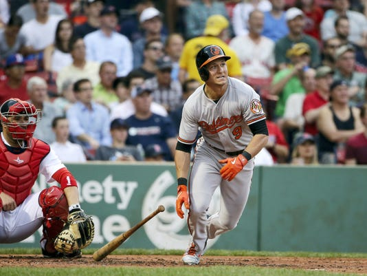 altimore Orioles' David Lough, right, watches the flight of his three-run home run as Boston Red Sox catcher Sandy Leon, left, looks on in the second inning at Fenway Park in Boston.