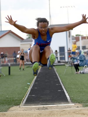 Ravenna's Jasmine Pooler during a long jump attempt at last year's regional meet.