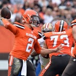 Cleveland Browns quarterback Johnny Manziel (2) throws a pass against the San Francisco 49ers during the second quarter at FirstEnergy Stadium.