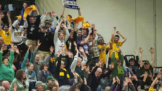 The Vermont student section cheers for the team during the men's basketball game between the Maine Black Bears and the Vermont Catamounts at Patrick Gym on Wednesday night.