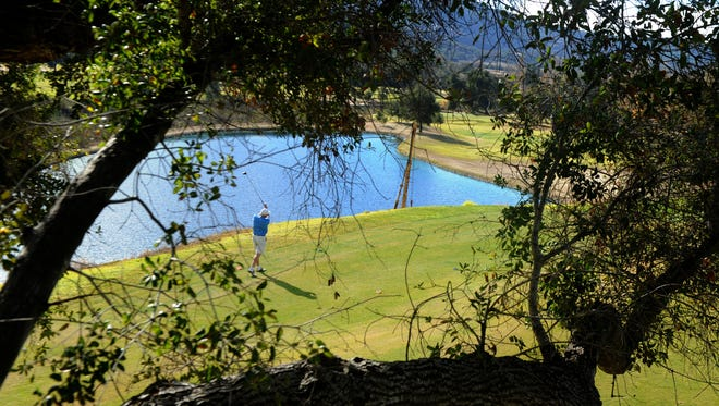 Mark Chaney tees off at Soule Park Golf Course in Ojai. Ventura County leaders are considering a smoking ban at most recreation areas, but golf courses would be exempted, partly because they're a revenue source for the county government.