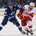 Tampa Bay Lightning left wing Ondrej Palat battles with Detroit Red Wings center Henrik Zetterberg in a game earlier this season.