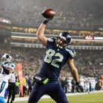 Jan 10, 2015; Seattle, WA, USA; Seattle Seahawks tight end Luke Willson (82) spikes the ball after scoring a touchdown against the Carolina Panthers in the 2014 NFC Divisional playoff football game at CenturyLink Field. Seattle defeated Carolina 31-17.