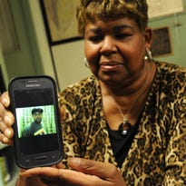Annie Mears displays a photograph of her son, James Wyatt, on her cellphone on Nov. 12. Wyatt was shot and killed at a pre-funeral party in July 2013. It was the second son Mears had lost to a violent crime.