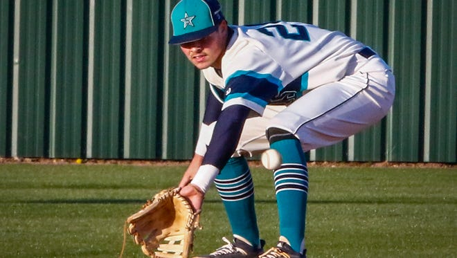 Siegel's Drew Benefield reaches for a grounder during Wednesday's contest against Stewarts Creek.