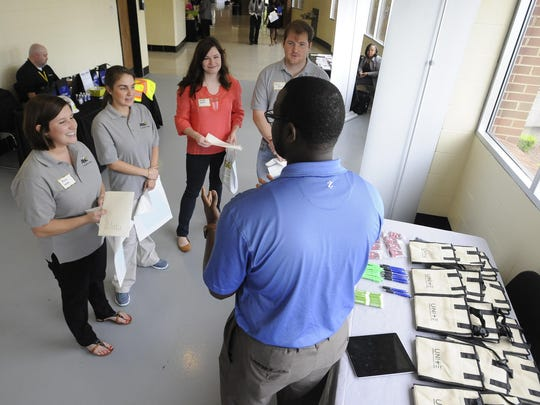 Anna Wicks, from left, Brianna Lutyk, Morgan Walker and Paul Sewell talk with David Marshall, of HealthSouth, at the Alabama State University Job Fair on the ASU campus in Montgomery, Ala. on Thursday April 9, 2015.