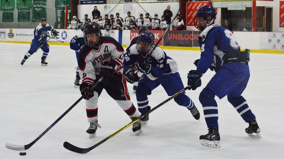 Byram Hills' Ethan Behar (11) moves the puck deep in