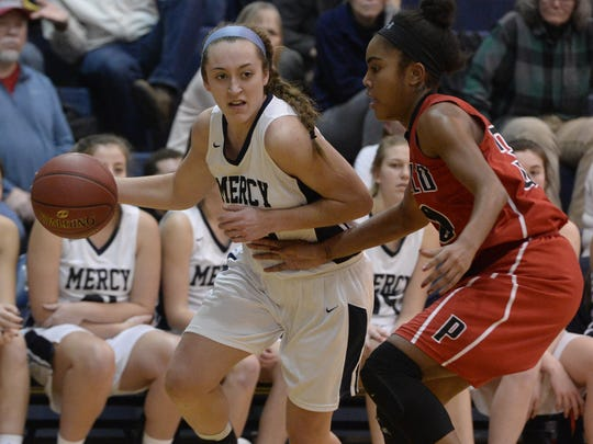 Mercy's Leah Koonmen, left, drives the baseline against Penfield's Makaila Wilson.