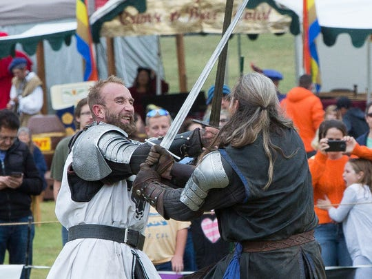 Sir Brawley Warbourne, left and Sir Ronan sword fight after a jousting tournament, during the Renaissance ArtsFaire, at Young Park November 5, 2016.