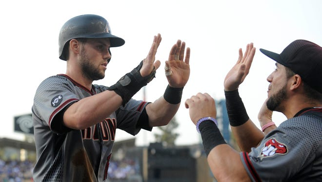 July 30, 2016: Arizona Diamondbacks center fielder Chris Owings (16) celebrates after scoring a run in the second inning against Los Angeles Dodgers at Dodger Stadium.