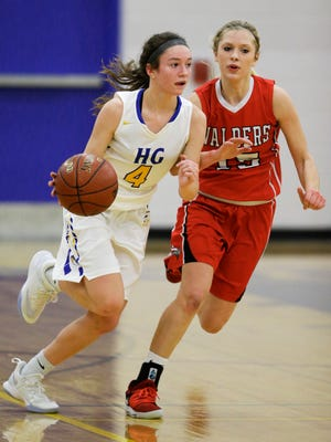 Howards Grove's Mackenzie Holzwart (4) drives past Valders' Jenna Evenson (15) on Saturday in Howards Grove.