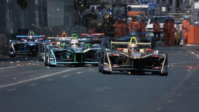 A pack of E cars heads for the straightaway.