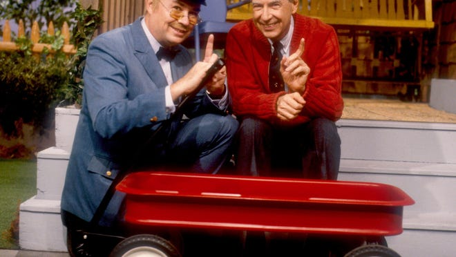 Delivery man Mr. McFeely (David Newell, left), and Rogers pose in the 'Neighborhood,' which was housed on a Pittsburgh sound stage where the series was filmed.