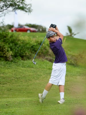 In this file photo, a 12-year-old Ivan Sablan tees off  in the 7th Annual BMW Junior Open golf tournament at the LeoPalace Resort.