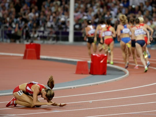 FILE – Morgan Uceny reacts after falling during the women's 1500-meter final during the 2012 Summer Olympics.