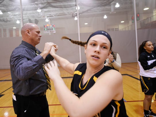 Red Lion head coach Don Dimoff high-fives his daughter,