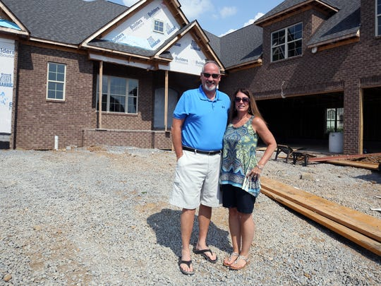 Mike and Karen Schulte at their soon-to-be completed home on the lake in Gallatin's Foxland Harbor golf community Tuesday July 25, 2017.