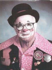 """Phil Huss as """"Smoky the Clown"""""""
