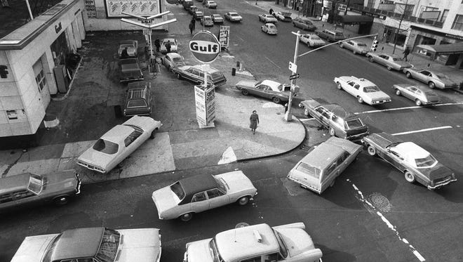Cars line up in two directions Dec. 23, 1973, at a gas station in New York City.  The gas station remained opened despite President Nixon's plea for stations to close on Sundays.