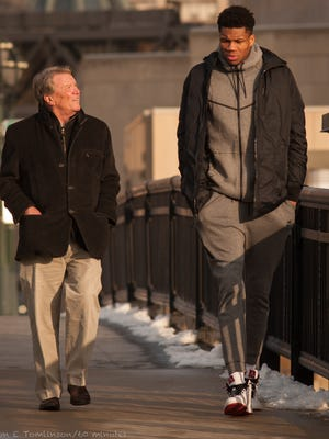 "Bucks superstar Giannis Antetokounmpo talks with  Steve Kroft of ""60 Minutes"" while walking in downtown Milwaukee."