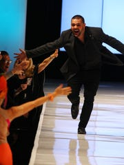 Michael Costello celebrates with is fans at the end of his show during the 2016  Fashion Week El Paseo on April 5, 2016.