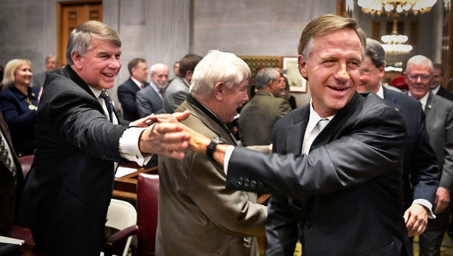 Gov. Bill Haslam shakes hands with Sen. Ed Jackson, R-Jackson, and other lawmakers as he makes his way to the podium to deliver his State of the State address Jan. 29, 2018, at the state Capitol.