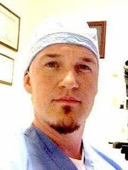 Dr. Darin Wolfe, a pathologist with Indiana Forensic