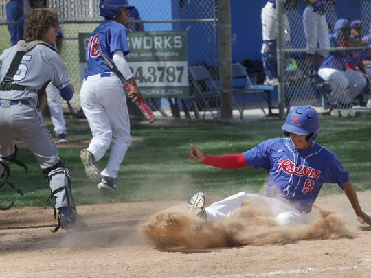 Michael Munoz of Indio slides into home plate for a run against Desert Christian Academy, March 28, 2016.