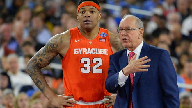 Head coach Jim Boeheim talks with center DaJuan Coleman in a game last season. Coleman is one of several veterans returning to the Orange.