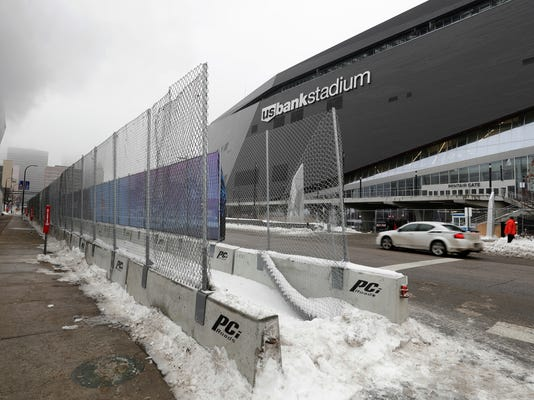 In this Thursday, Jan. 25, 2018 photo, barricades are viewed near U.S. Bank Stadium in preparation for the NFL Super Bowl football game in Minneapolis. The Philadelphia Eagles play the New England Patriots on Sunday, Feb. 4. (AP Photo/Matt Slocum)