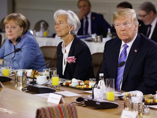 President Donald Trump listens during the Gender Equality Advisory Council breakfast during the G-7 summit, Saturday, June 9, 2018, in La Malbaie, Quebec, Canada. From left, German Chancellor Angela Merkel, IMF Managing Director Christine Lagarde, and Trump. (AP Photo/Evan Vucci)