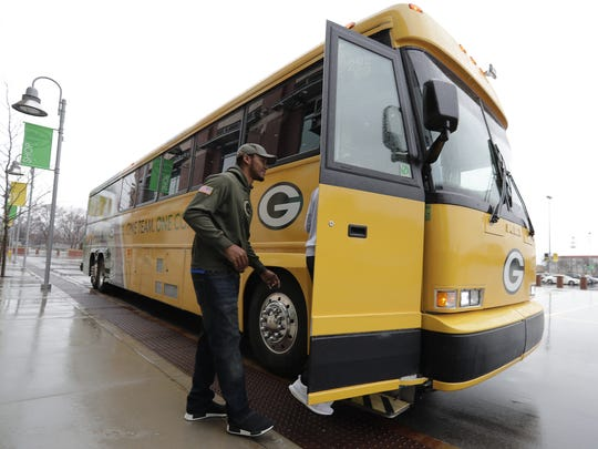 Packers quarterback Brett Hundley boards the bus at Lambeau Field to depart for the 2017 Packers Tailgate Tour.
