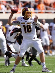 Central Michigan quarterback Cooper Rush throws a pass during the first half of an NCAA college football game against Oklahoma St in Stillwater, Okla., Saturday, Sept. 10, 2016.(AP Photo/Brody Schmidt)