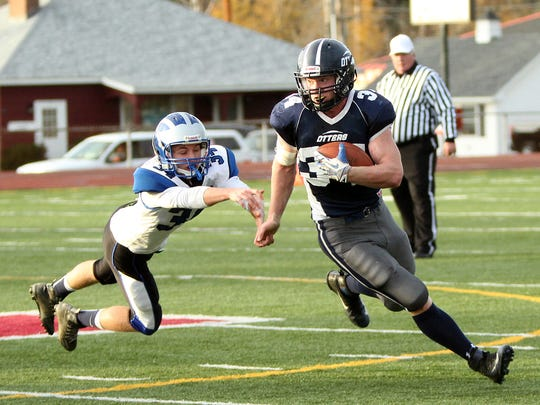 Otter Valley's Carson Leary avoids a tackle attempt