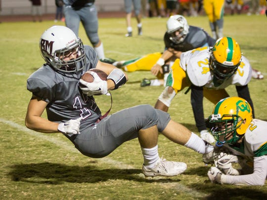 Rancho Mirage's Gabriel Maldonado tackled by an Arab