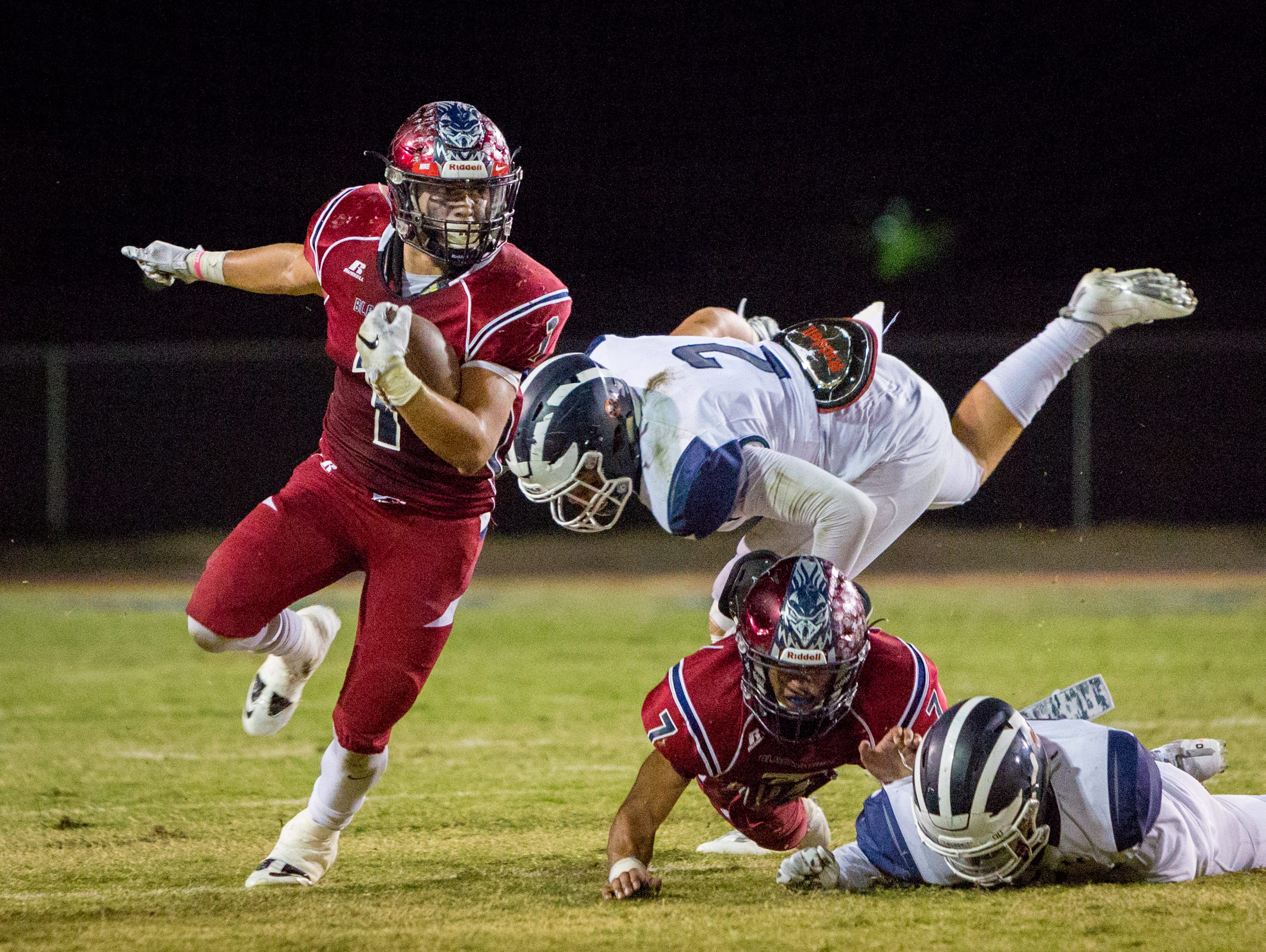 Benji Cordova avoids getting tackled for a gain of eight yards in the first half against Redlands.