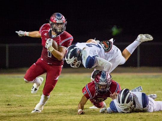 Benji Cordova (#1) avoids getting tackled for a gain of 8 yards.