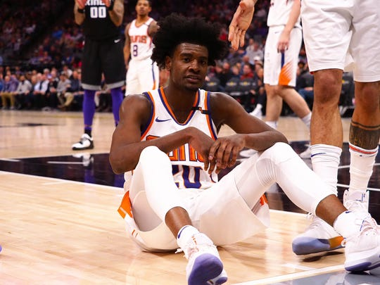 Suns forward Josh Jackson sits on the floor as he is called for a foul on Tuesday in Sacramento.