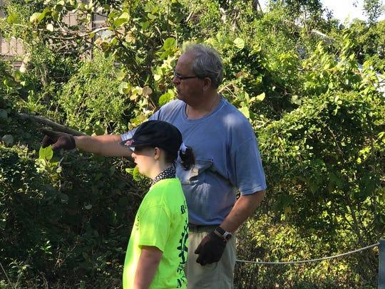 Local Historian Craig Woodard provides a young volunteer