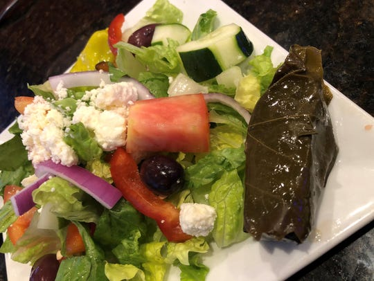 A side Greek salad at Olympia Dining, Naples.