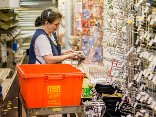 Janet Smyth packs up inventory to move to Middletown Hardware's New Castle location on Wednesday afternoon.