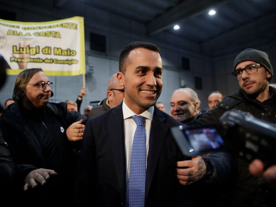 5-Star Movement's premier candidate Luigi Di Maio smiles